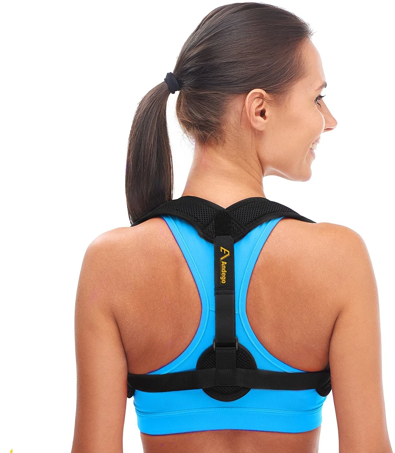 A person is wearing a posture corrector pictured from the back