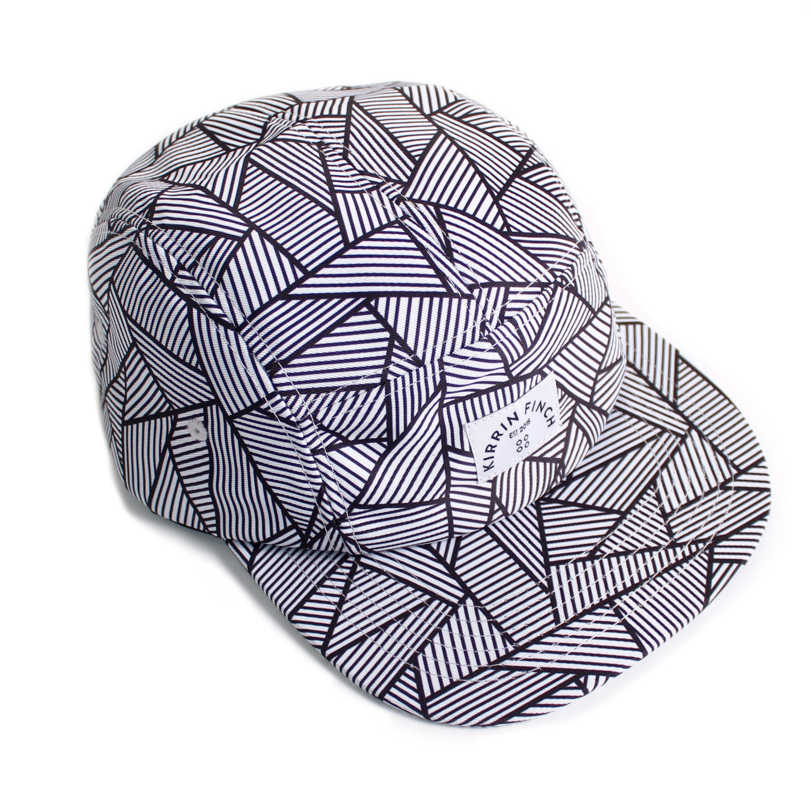 The hat with black and white lines and triangle print with a rectangle in the middle with the brand logo on it