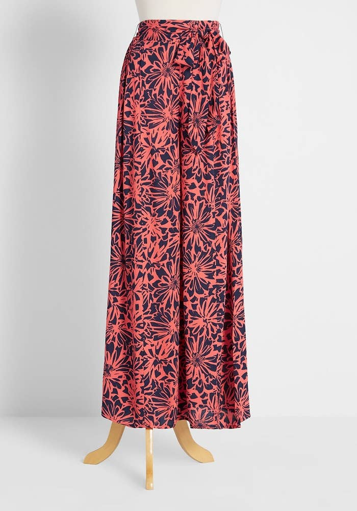 The trousers with a navy and pink floral print and a high waist with removable tie