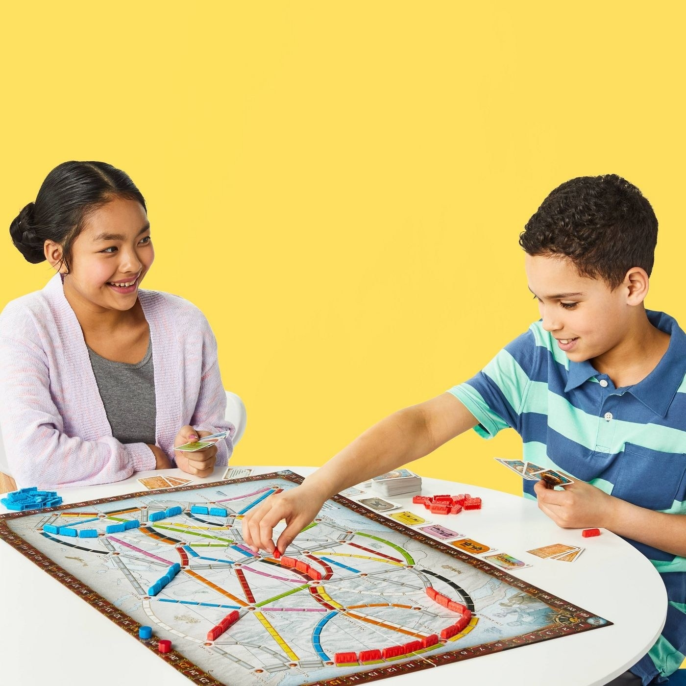 Two models playing the colorful boardgame