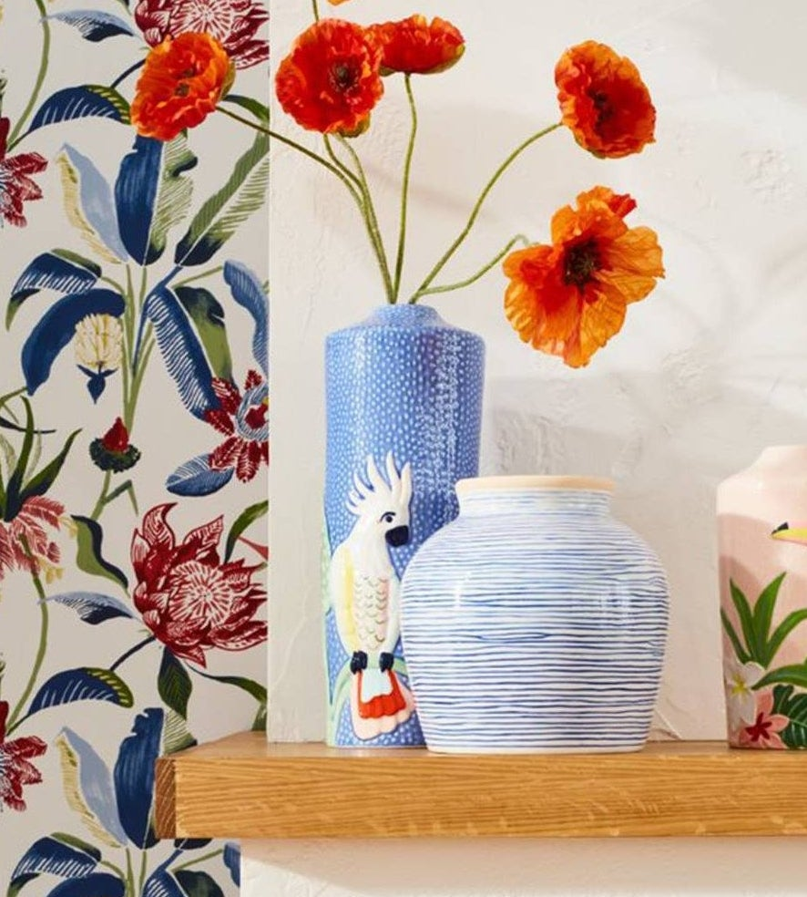 A light blue vase with a white bird on it