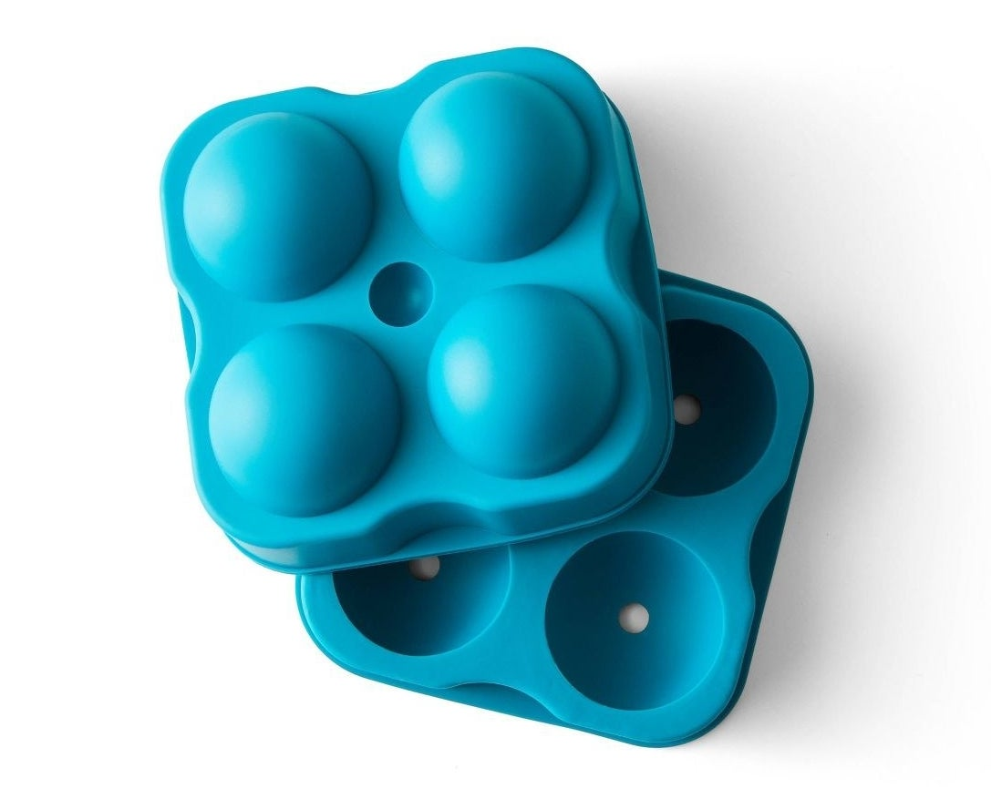 A two-piece, aqua-colored round ice mold