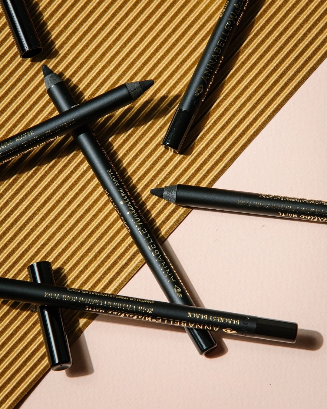 A small pile of eyeliner pencils