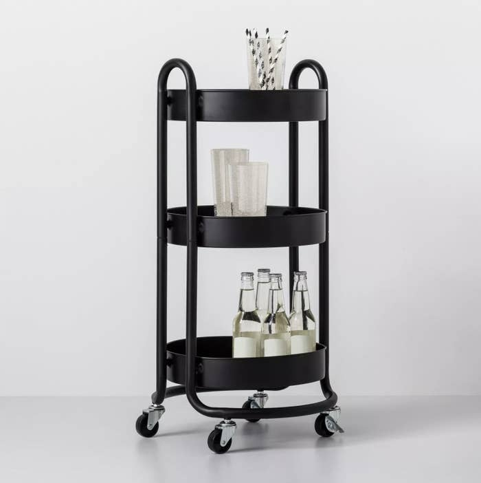 The black rolling utility cart