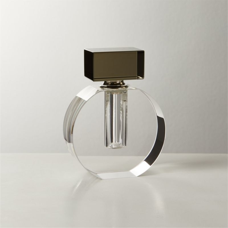 the clear bottle with a smoked glass top