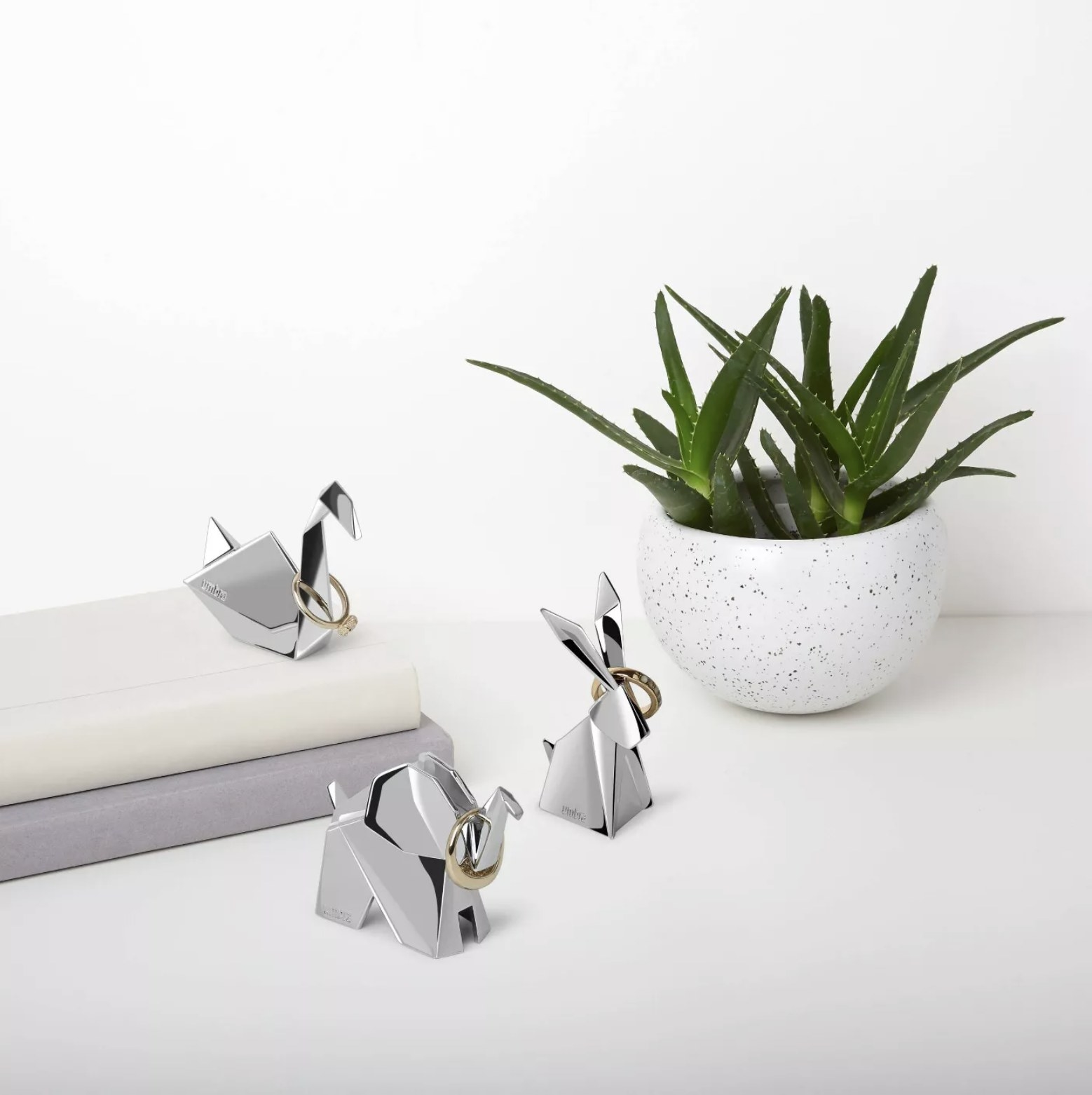 The silver elephant- swan- and rabbit-shaped ring holders