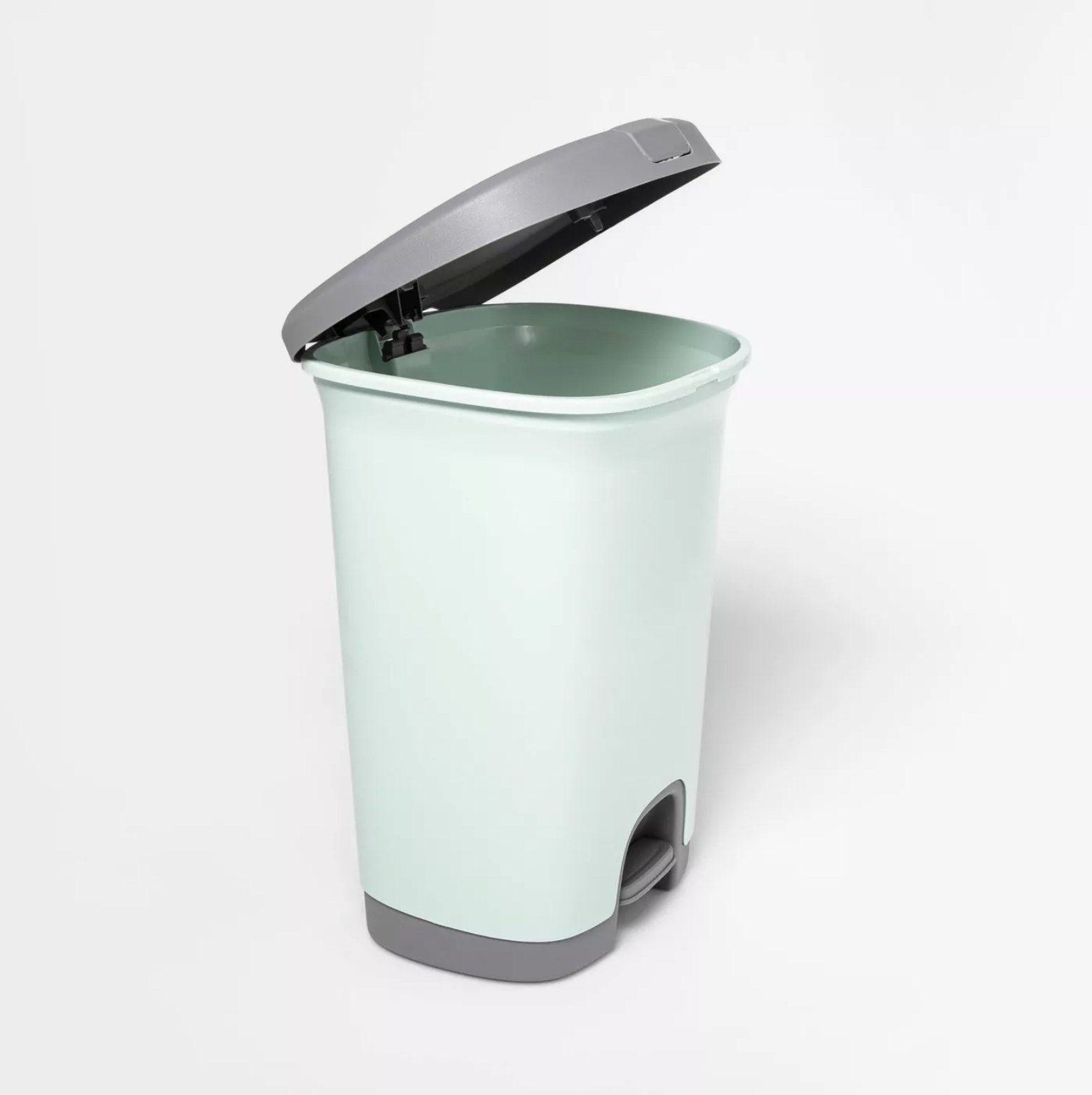 The mint-colored trash can