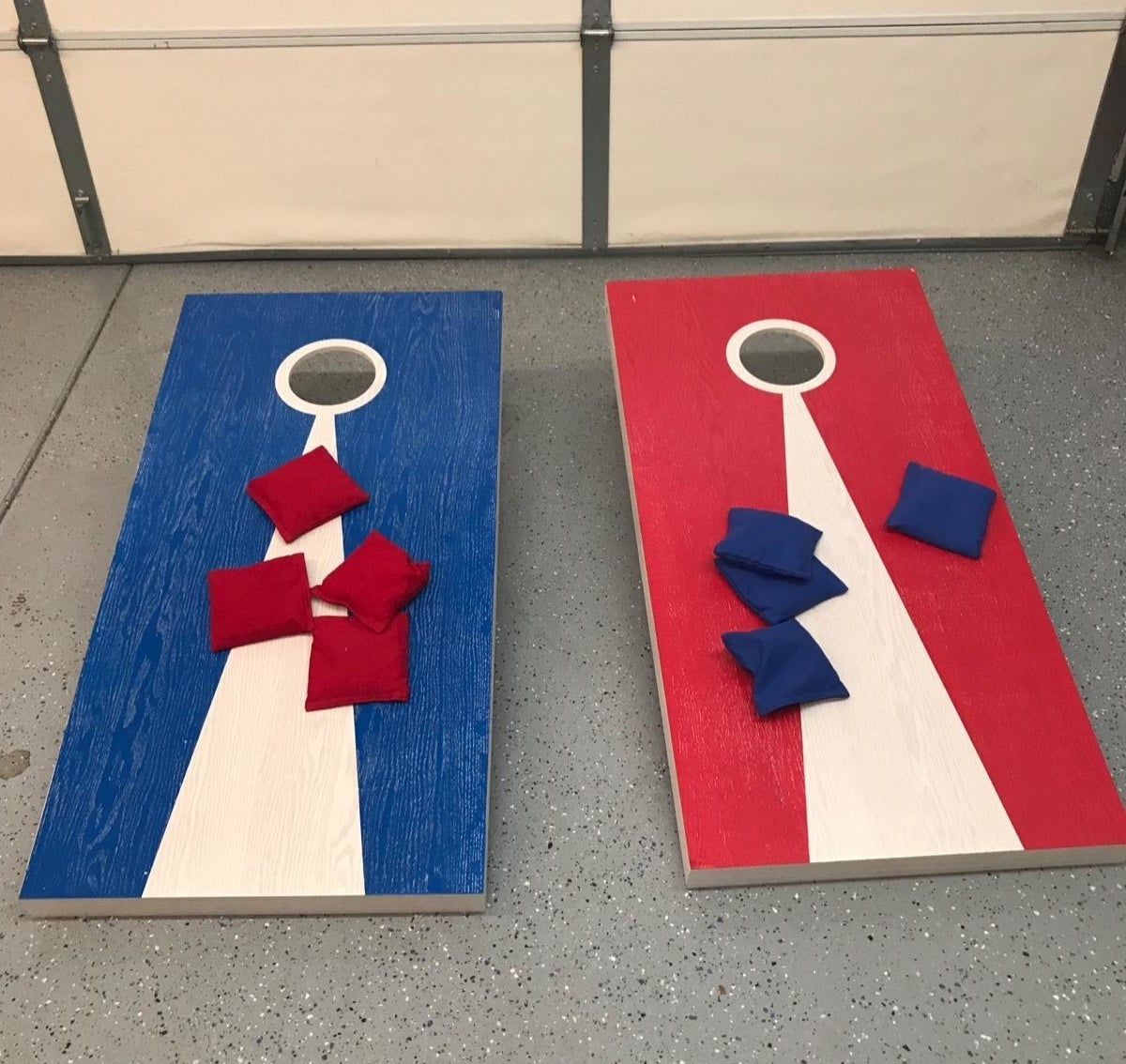 red and blue cornhole boards with red and blue beanbags