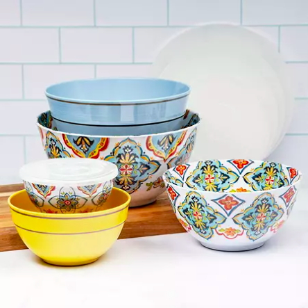 printed and solid color bowls stacked on a wood cutting board