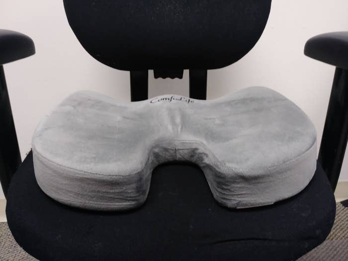 the u-shaped pillow on chair