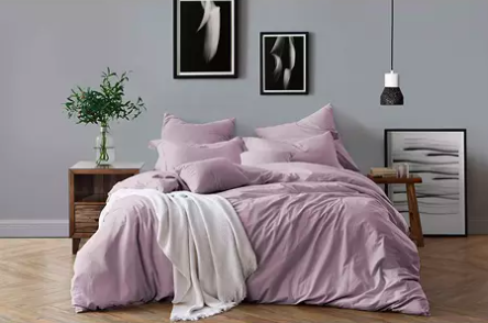 bedroom with bed with purple bedding on it
