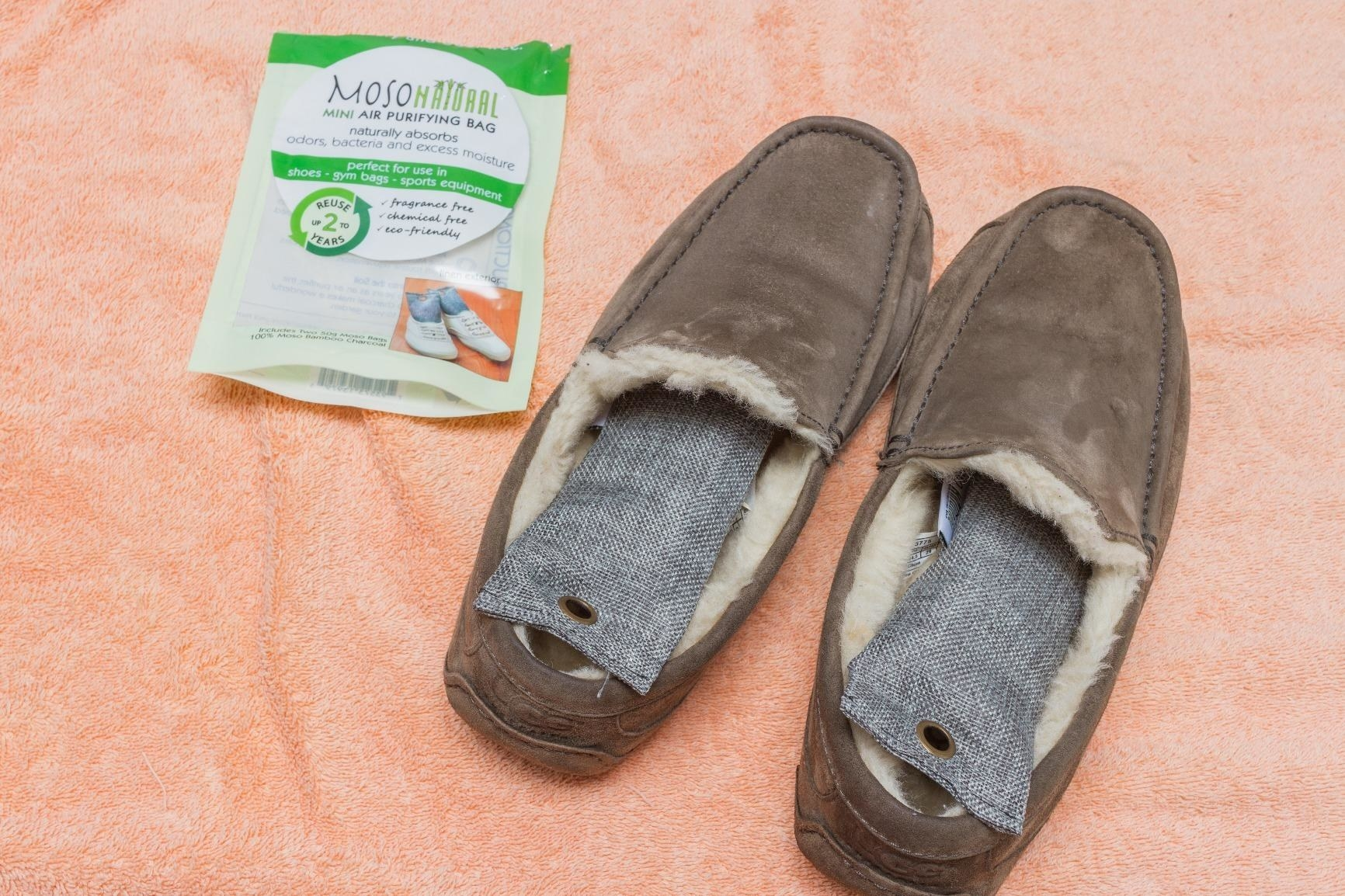 A reviewer's narrow rectangular deodorizers inside a pair of fur-lined shoes