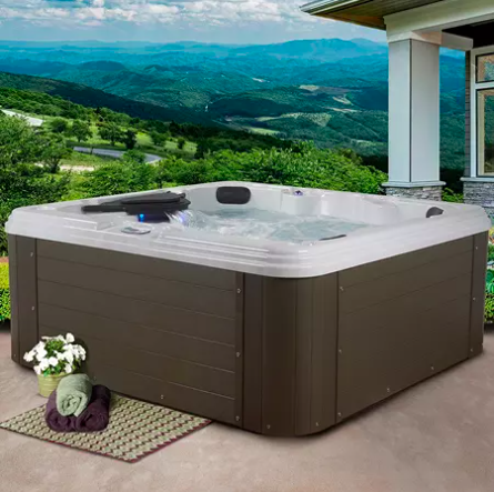 square shape hot tub with wood look exterior on a patio