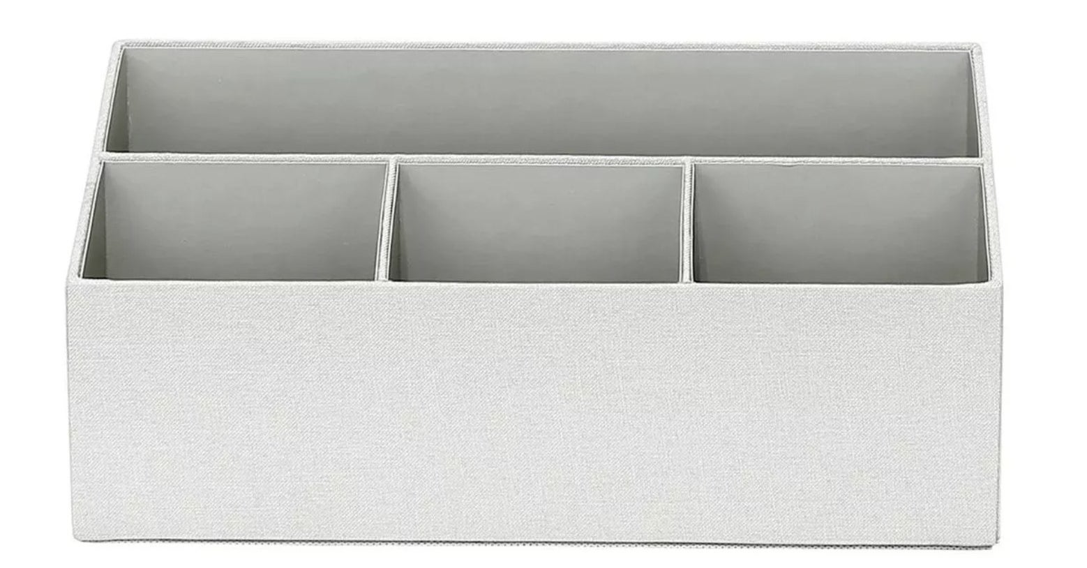 The grey fabric desk organizer with four compartments