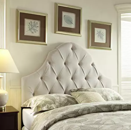beige tufted headboard in bedroom