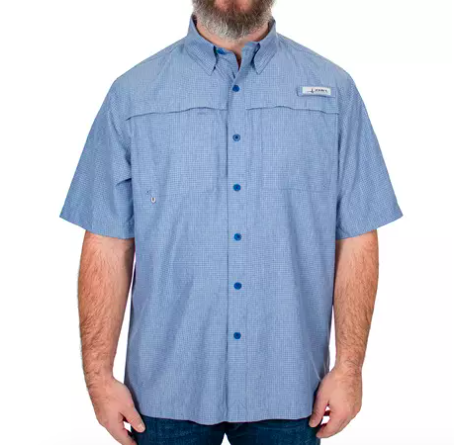 person wearing a boxy fit button-down short sleeve shirt in light blue