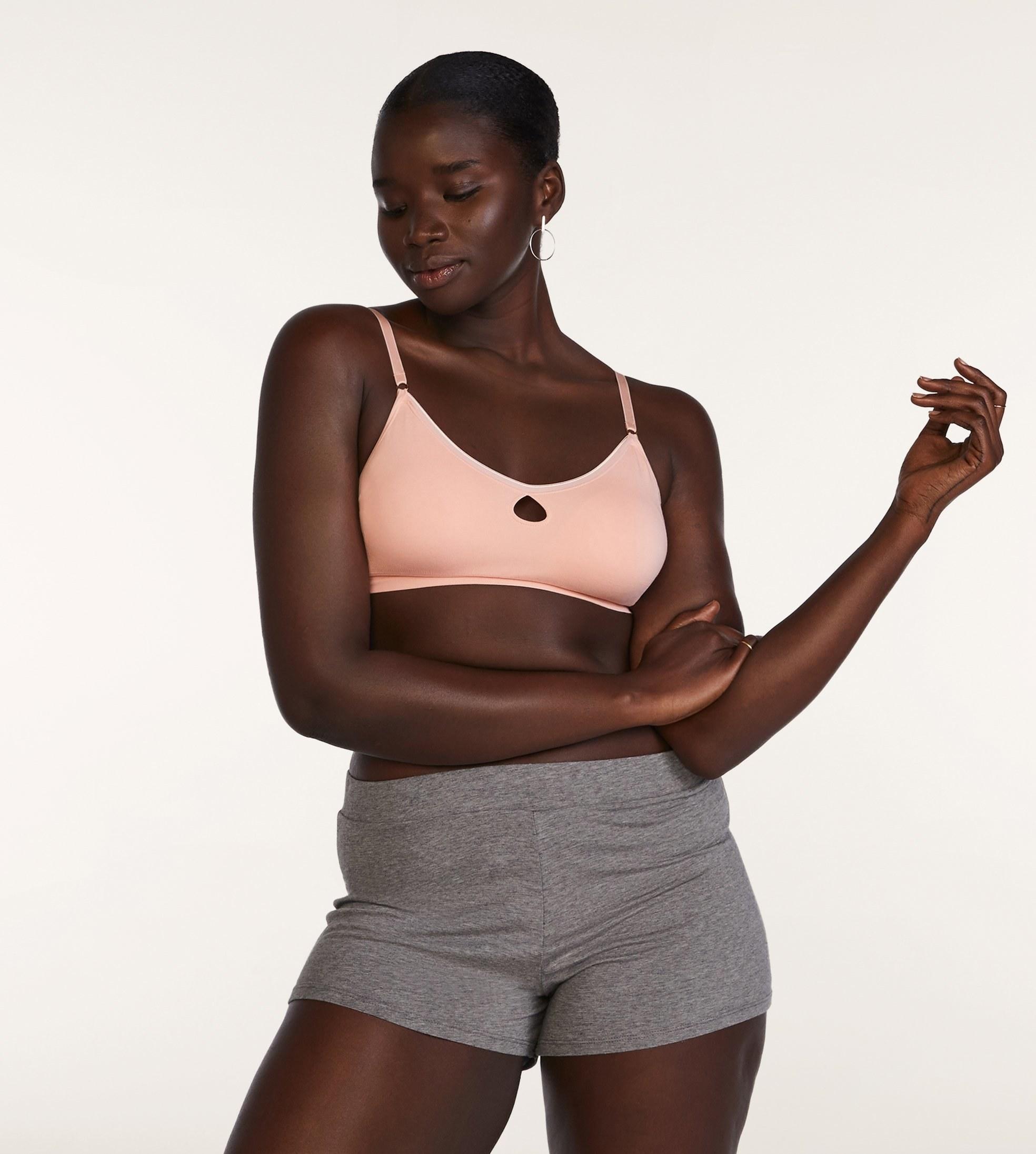 model wearing pink bralette