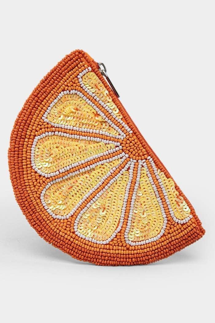 beaded change purse with a zipper that looks like an orange slice