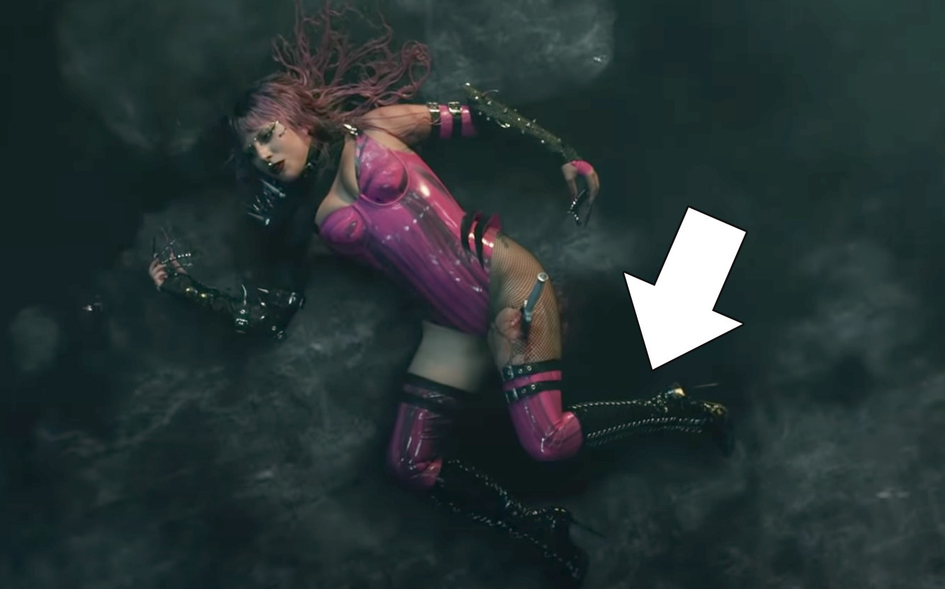 "Lady Gaga lying down on the floor in the ""Rain On Me"" music video"