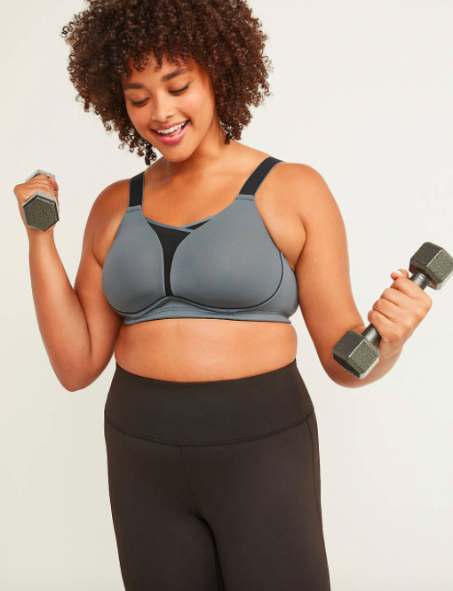 Model wears a grey LIVI Active Medium-Impact Cooling No-Wire Sport Bra while lifting weights
