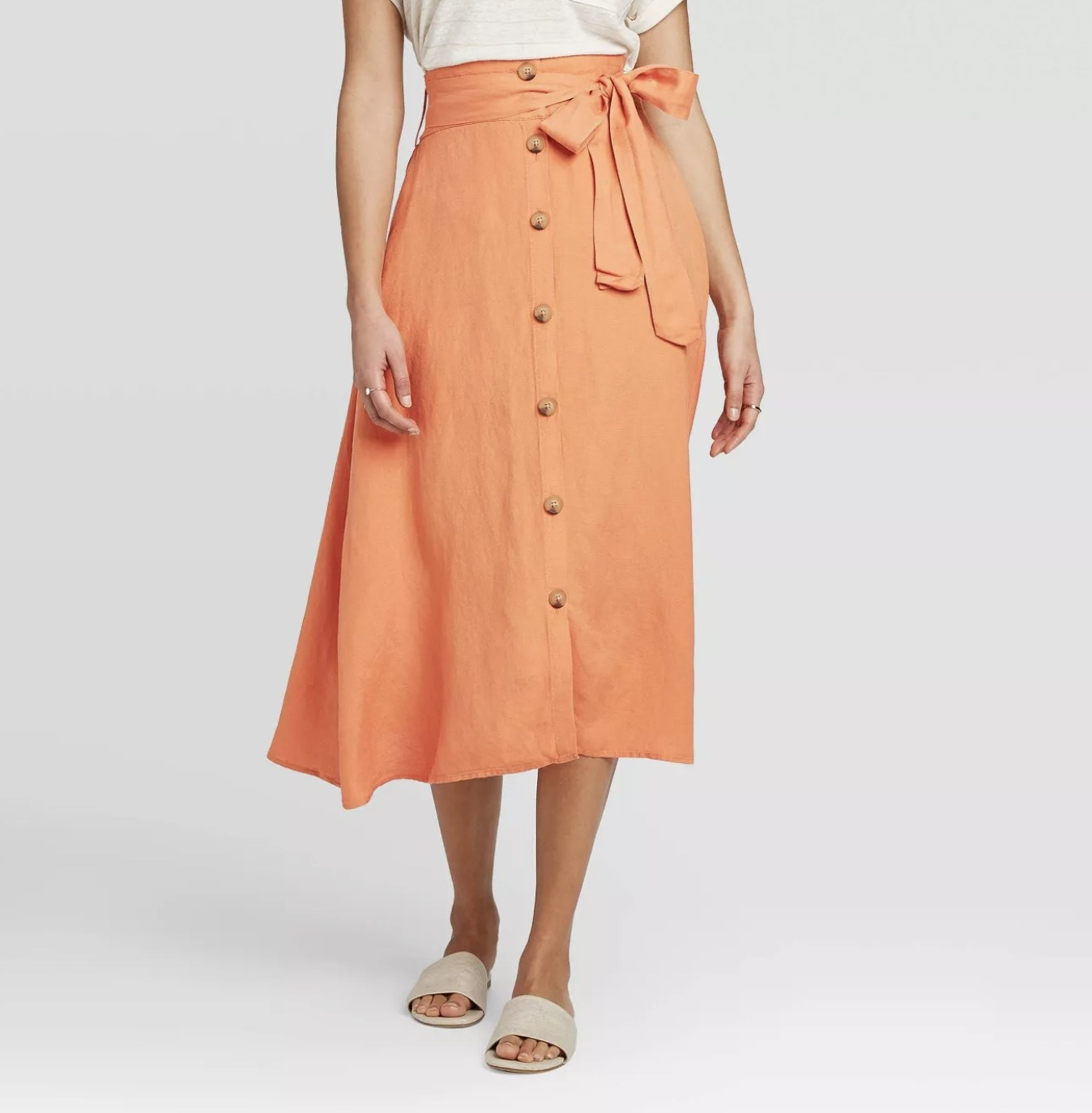 Model wearing the belted, button-down midi skirt