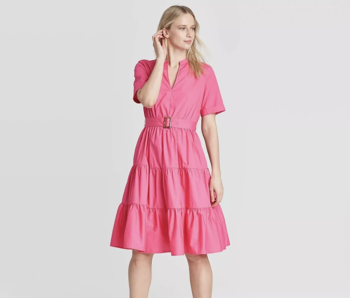 Model in the ruffled, short-sleeve pink dress