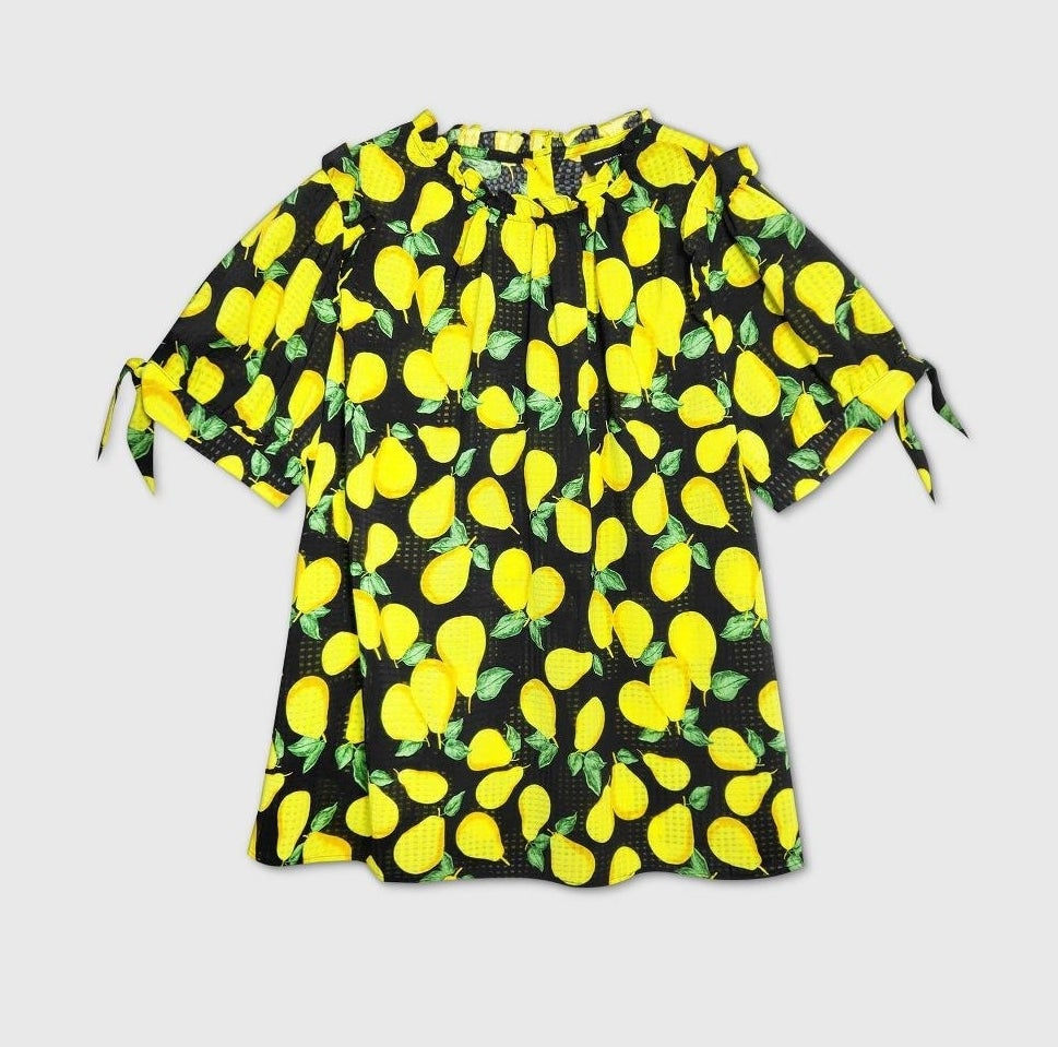 A black shirt with a yellow pear pattern
