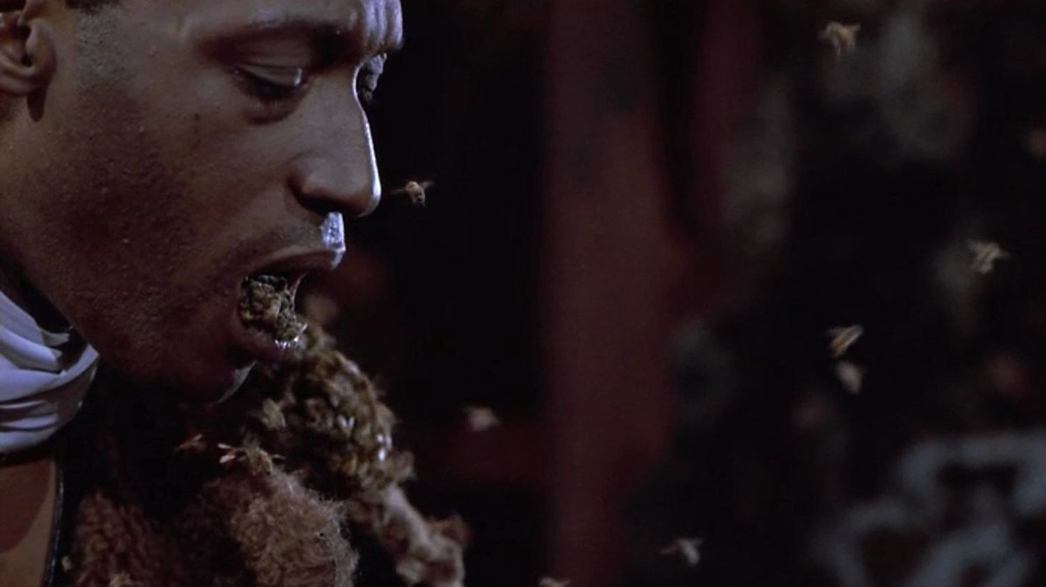 """Actor Tony Todd as the titular """"Candyman"""" with a whole bunch of real live bees pouring out of his mouth."""