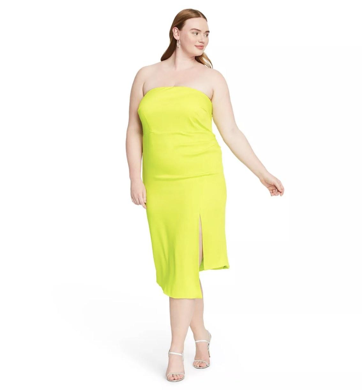 Model wearing the neon green strapless dress