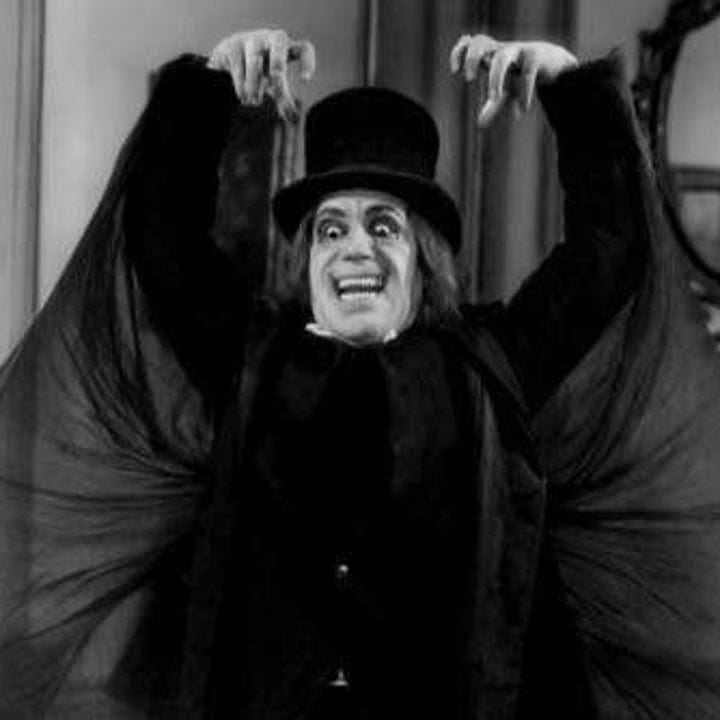 Lon Chaney wearing an almost-identical look to the Babadook, including a top hat and pointy teeth.