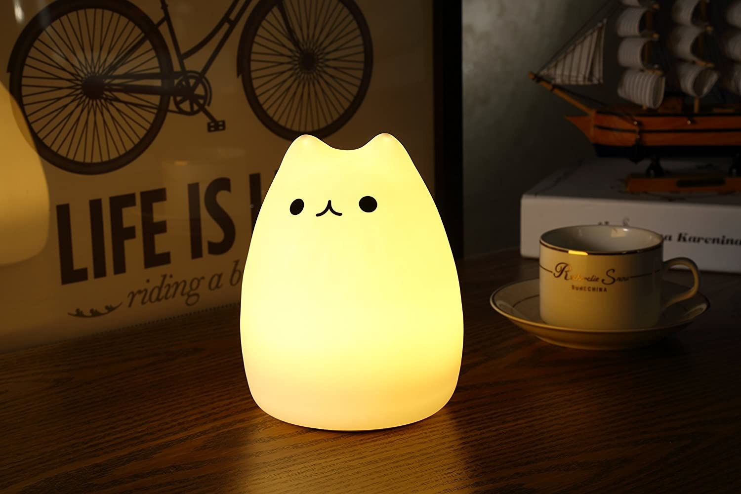 A soft yellow LED cat light is illuminated