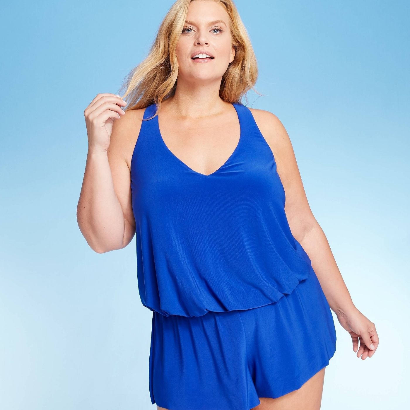 A blue swim romper with a v neck cinched slightly below the waist
