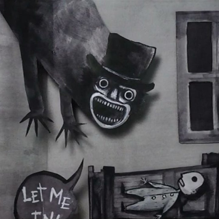 A picture book featuring a pop-up of The Babadook, sporting a top-hate and pointy teeth.