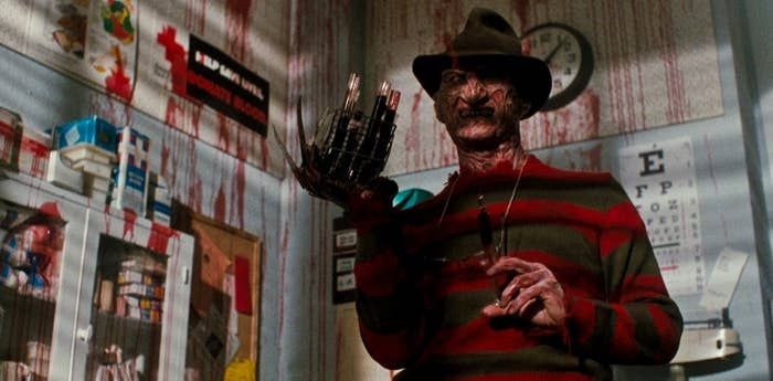Actor Robert Englund as Freddy Kruger, brandishing his terrifying claws and sporting his usual red and green sweater.
