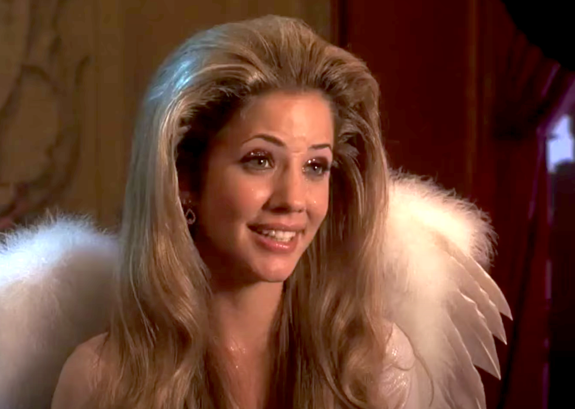 Shelby with pink glittery eyeshadow and blown out hair in an angel costume