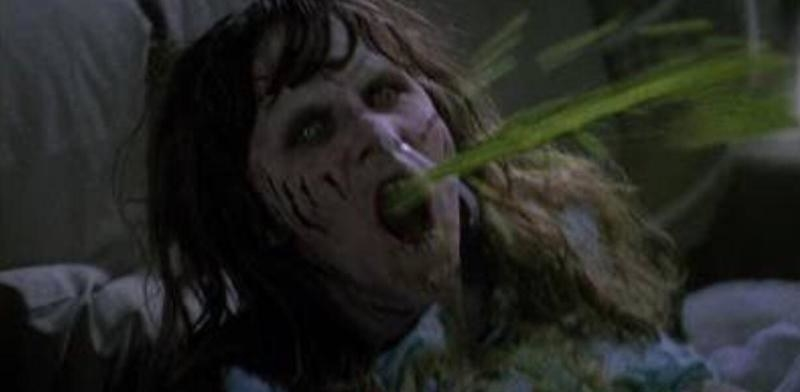 Actor Linda Blair as a posses Regan vomiting large amounts of bright green puke (sorry).