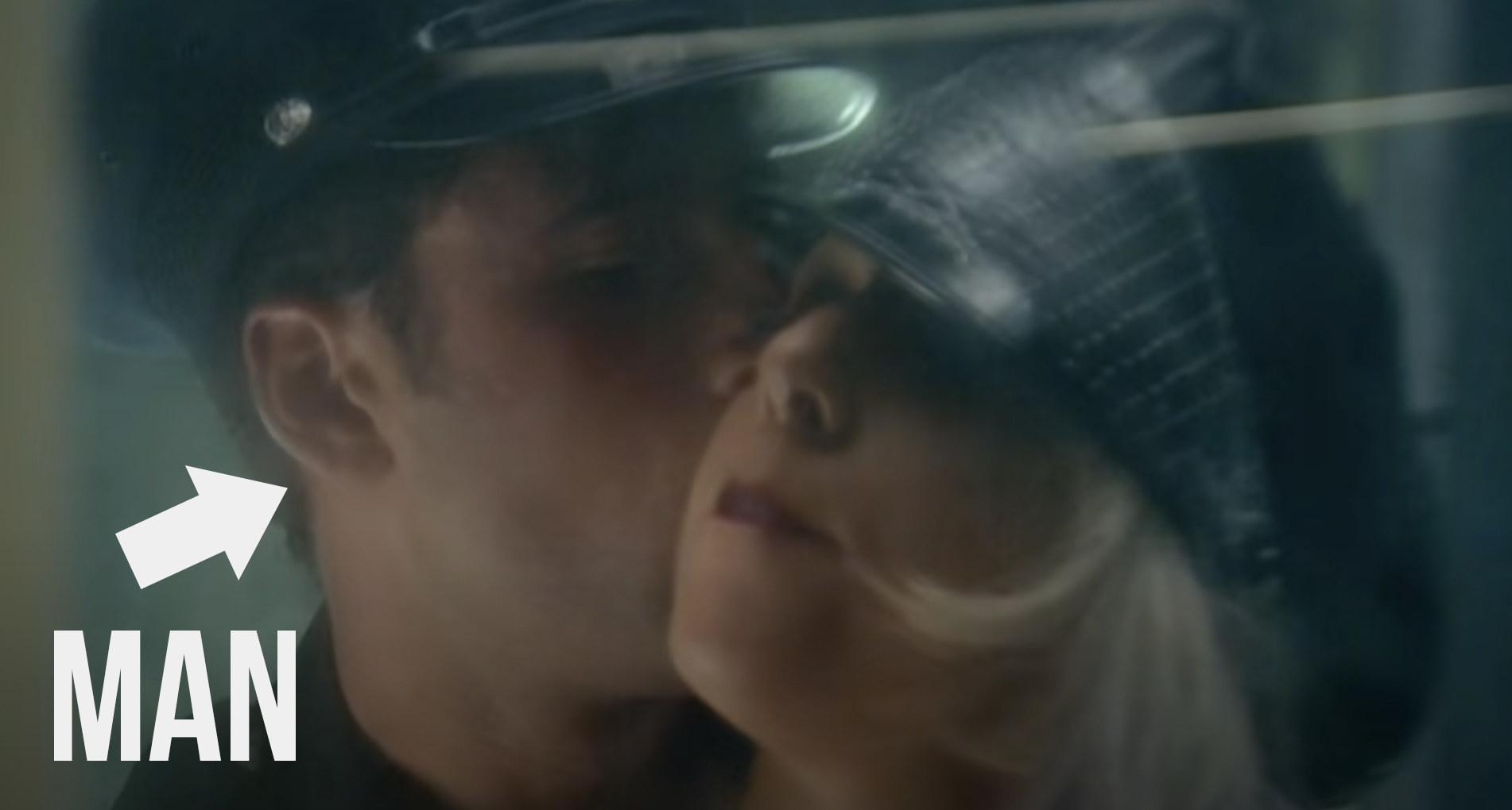 Gaga getting kissed by a male subway ticket inspector
