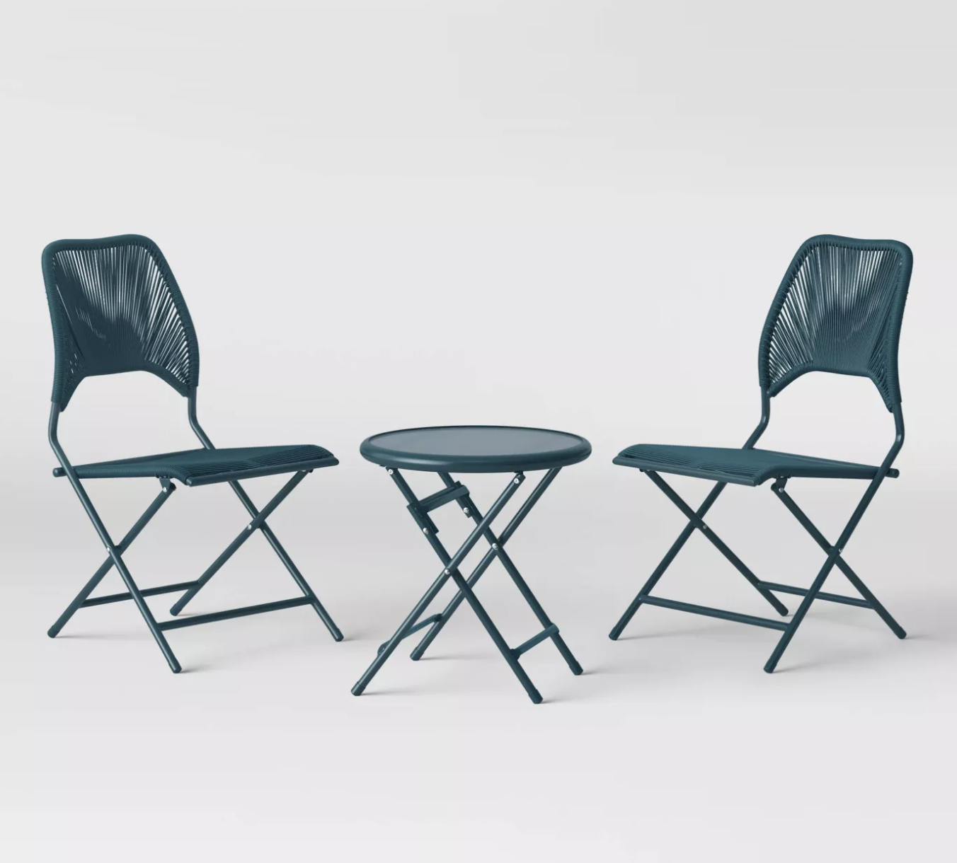 two teal folding chairs and matching small round table
