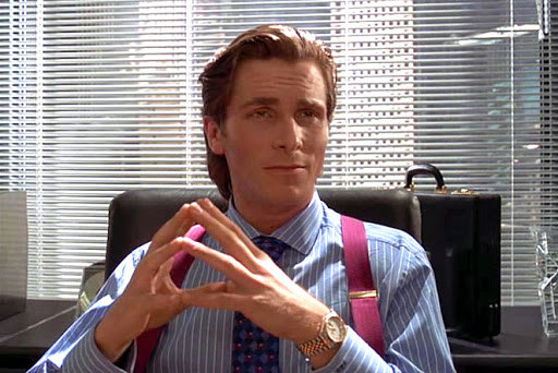 Actor Christian Bale as fictional serial killer Patrick Bateman, sporting a very fancy watch.