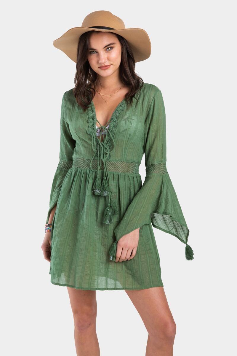 model wearing sheer green long sleeve dress with swim suit peeking through the fabric