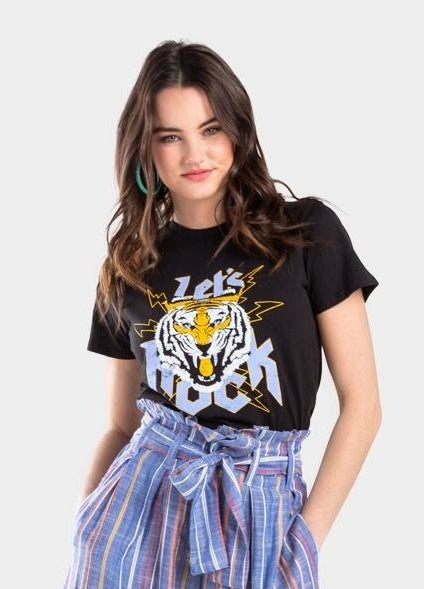 """model wearing a black rock style T-shirt with a tiger and lightning bolts on it that says """"Let's rock"""""""