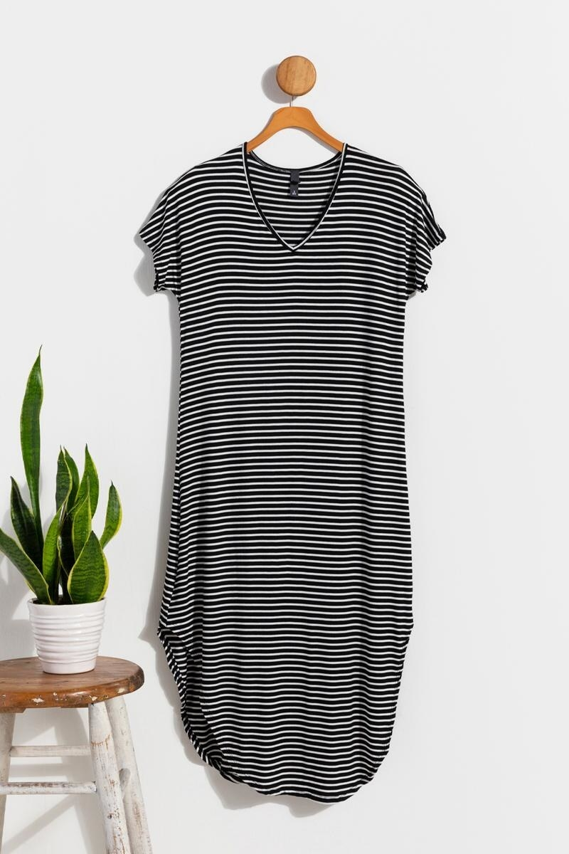 short sleeve maxi dress with V-neck and curved hem in black and white stripe fabric hanging up on a coat hanger