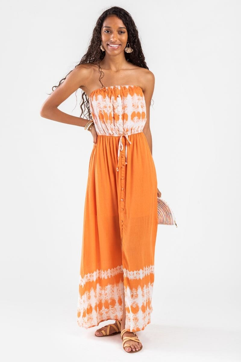 model wearing sleeveless orange and white tie-dye dress with tie-dye patterns at top, bottom, with solid orange in the middle