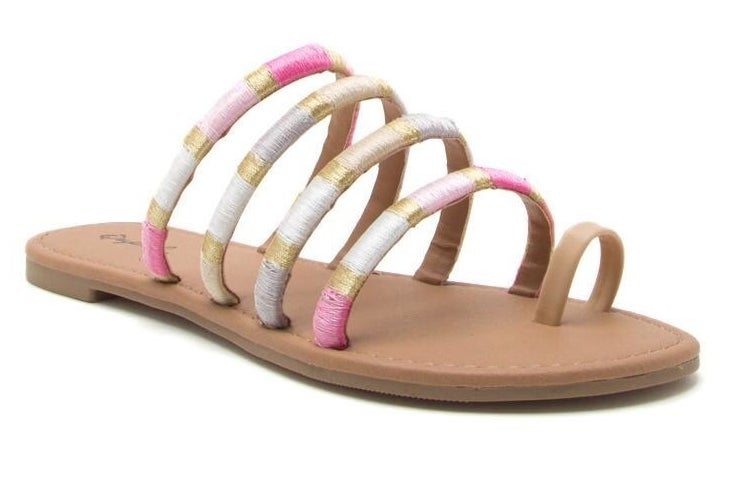 light brown faux leather flat sandals with four bands across foot and a big toe loop. Pastel and metallic gold thread wrapped around the big bands