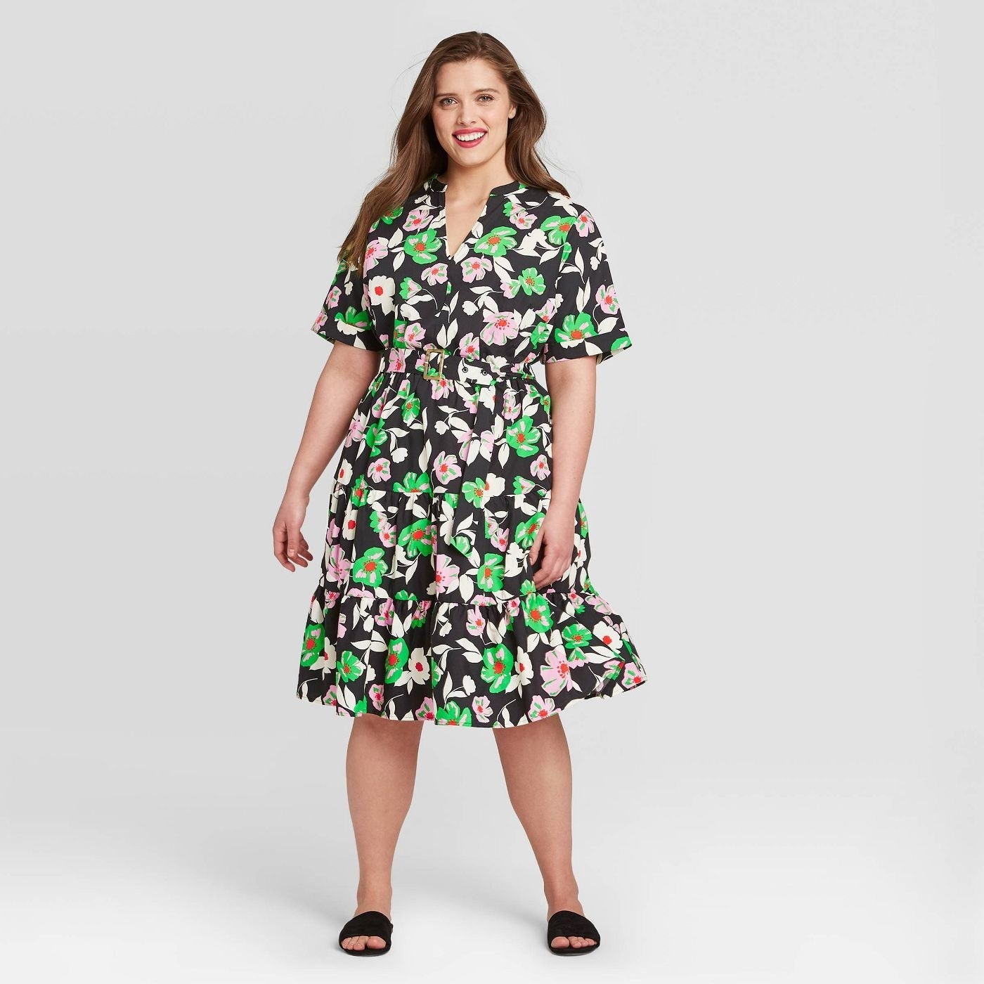 A black short-sleeved dress with pink and green florals
