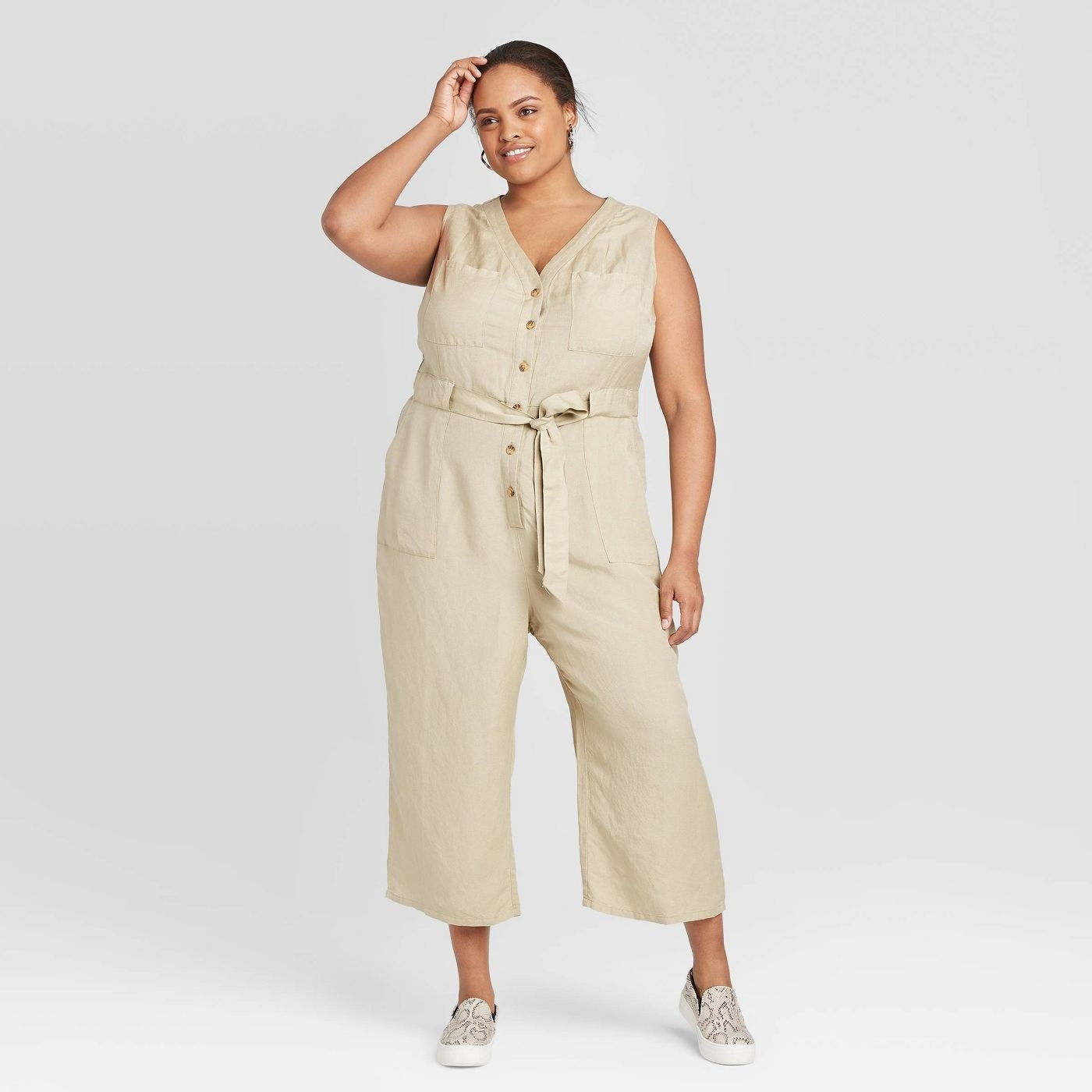 A model in the beige jumpsuit