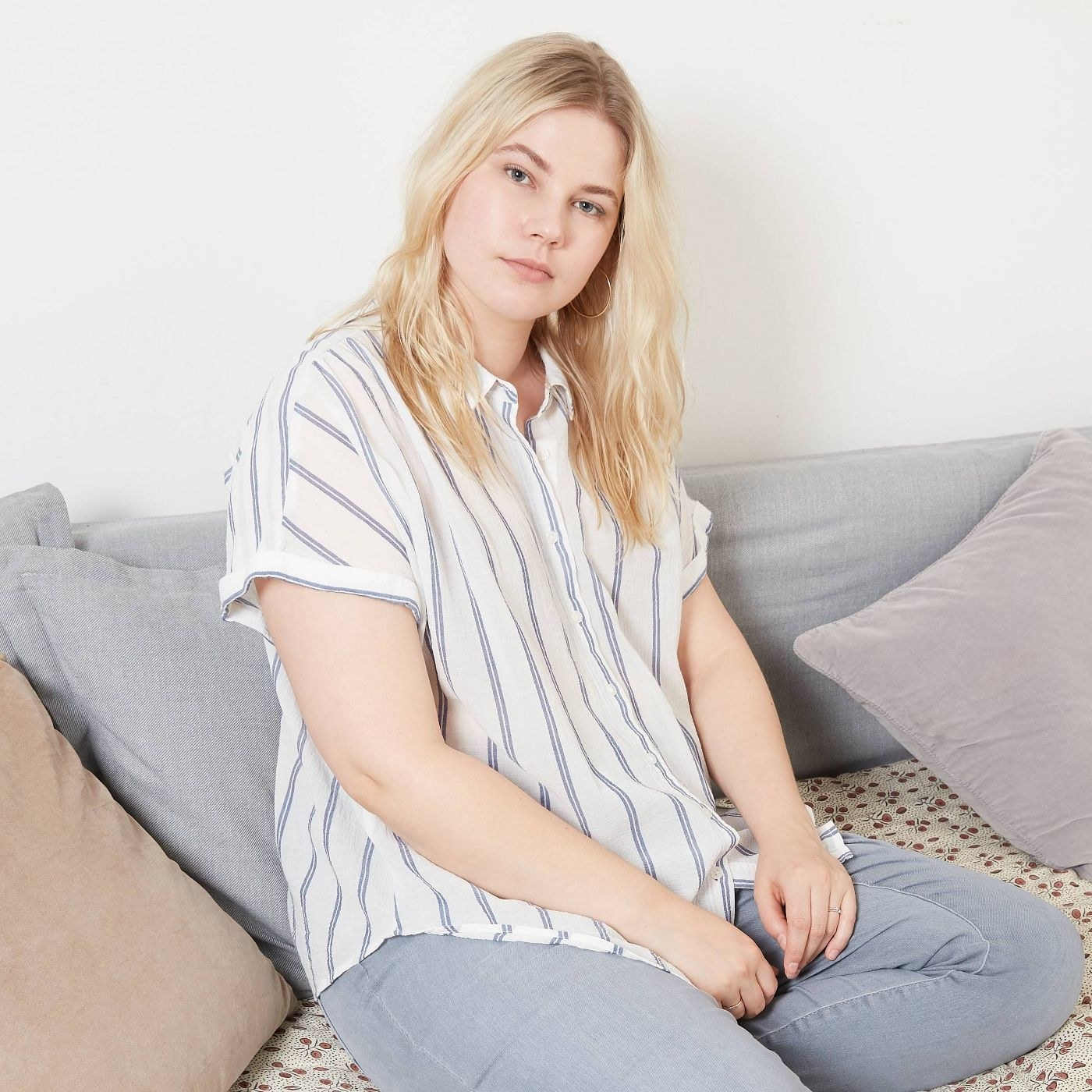 A model in the white blouse with blue stripes