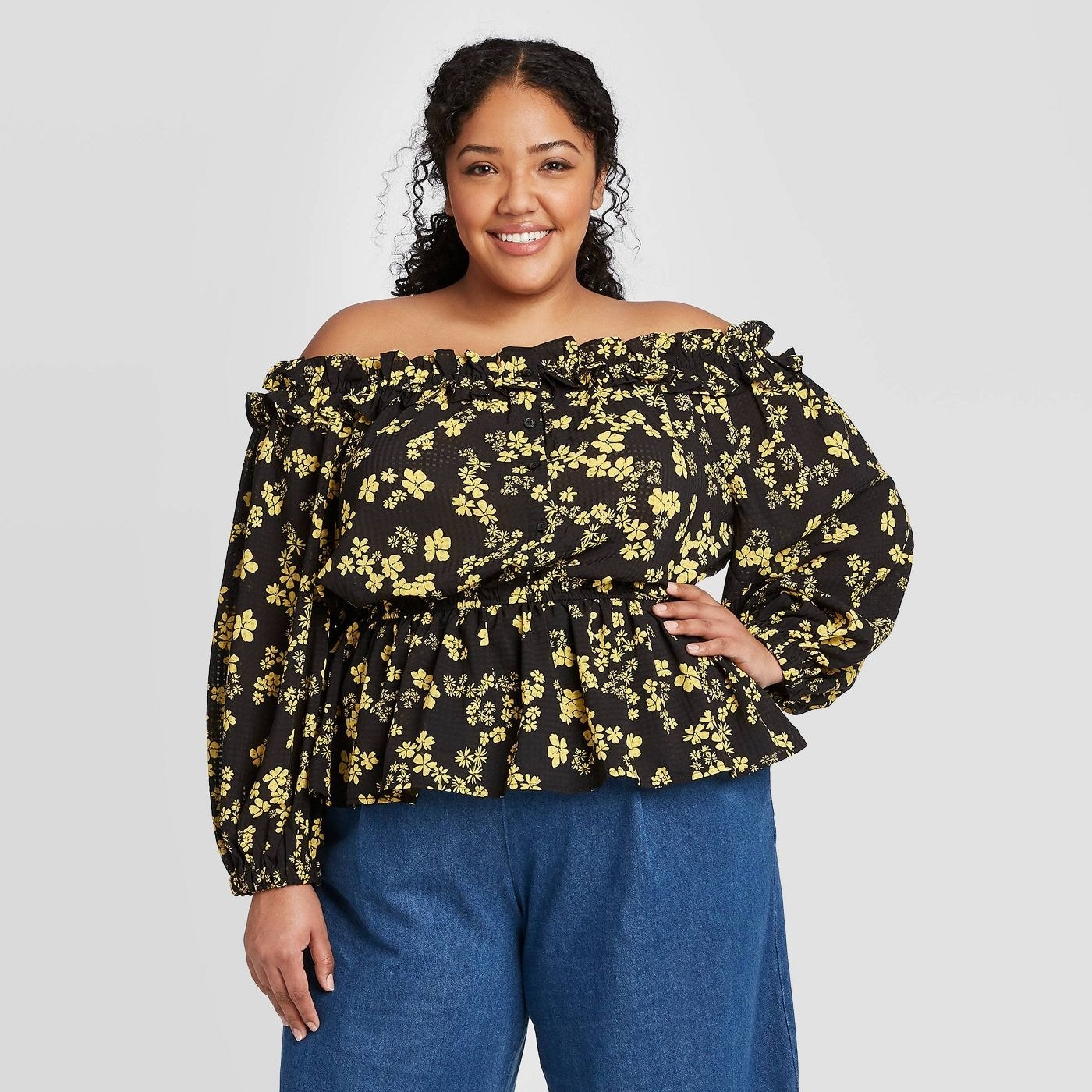 A long sleeved top with ruffled detailing at the neckline hem