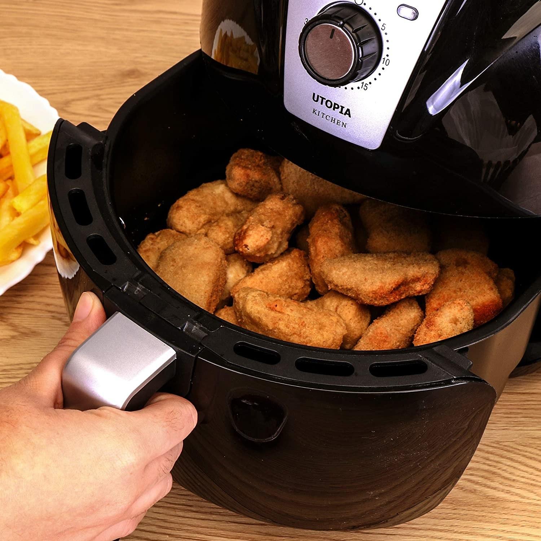 An air fryer cooking chicken wings
