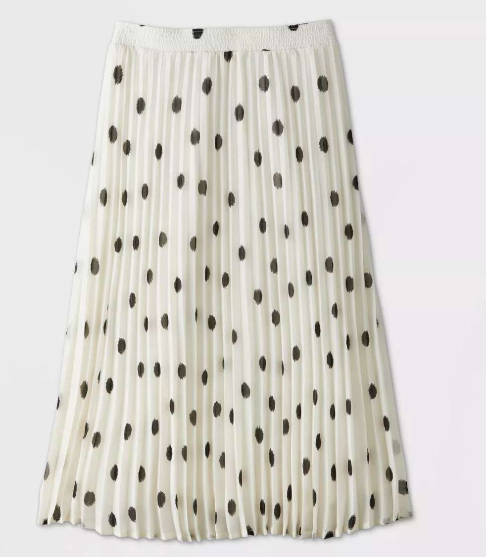 pleated white skirt with black dots